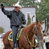 FILE - In this 2010 photo, Milwaukee County Sheriff David Clarke Jr. rides his horse during the Mexican Independence Day Parade in Milwaukee, Wis. The Wisconsin sheriff said he released an ad calling on residents to defend themselves because the old model of having a citizen call 911 and wait for help isn\'t always the best option. (AP Photo/Milwaukee Journal Sentinel, John Klein, file)