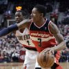 Washington Wizards guard Bradley Beal, right, drives past Portland Trail Blazers guard Wesley Matthews during the first quarter of an NBA basketball game in Portland, Ore., Monday, Jan. 21, 2013. (AP Photo/Don Ryan)