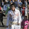 An Elvis impersonator walks in the University of Central Oklahoma\'s homecoming parade in Edmond, OK, Saturday, November 3, 2012, By Paul Hellstern, The Oklahoman