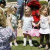 Lindsey Martin takes a photo of two-year-olds Addison Martin, Gaby Alspaugh, and Madelyn Conner, during the UCO Easter Egg Hunt and Carnival at Plunkett Park on the campus of the University of Central Oklahoma in EdmondOK, Saturday, April 16, 2011. By Paul Hellstern, The Oklahoman
