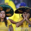 Brazil fans grieve after the World Cup semifinal soccer match between Brazil and Germany at the Mineirao Stadium in Belo Horizonte, Brazil, Tuesday, July 8, 2014. Germany beat Brazil 7-1 and advanced to the final. (AP Photo/Frank Augstein)