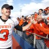 Oklahoma State\'s Brandon Weeden (3) celebrates the Cowboys\' win over Kansas with fans, Saturday, Nov. 20, 2010 at Memorial Stadium in Lawrence, Kan. Photo by Sarah Phipps, The Oklahoman