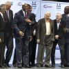 FILE - In this Nov. 7, 2011 file photo, Los Angeles Lakers owner Jerry Buss, third from right, looks towards Magic Johnson, third from left, during a ceremony of the Magic Johnson Foundation in Los Angeles. Also shown are former Lakers team members Pat Riley, left, Mitch Kupchak, second from left, Bill Sharman, second from right, and James Worthy, right. Buss, the Lakers\' playboy owner who shepherded the NBA franchise to 10 championships, has died. He was 80. Bob Steiner, an assistant to Buss, confirmed Monday, Feb. 18, 2013 that Buss had died in Los Angeles. Further details were not available.(AP Photo/Damian Dovarganes, FIle)