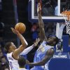 Photo - Oklahoma City Thunder guard Russell Westbrook (0) shoots as Denver Nuggets forward J.J. Hickson (7) defends in the second quarter of an NBA basketball game in Oklahoma City, Monday, Nov. 18, 2013. (AP Photo/Sue Ogrocki)