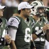 Photo - FILE - In this Aug. 10, 2012, file photo, New York Jets quarterbacks, from left, Greg McElroy, Mark Sanchez and Tim Tebow watch from the sidelines during the first half of a preseason NFL football game against the Cincinnati Bengals in Cincinnati. Jets coach Rex Ryan gathered his three quarterbacks Wednesday morning and told them he had made up his mind. It will be Sanchez and not McElroy orTebow on Sunday when the Jets take on the Jaguars in Jacksonville.(AP Photo/Tom Uhlman, File)