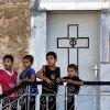 Photo - Palestinian boys play on the grounds of the St. Porphyrios Church in Gaza City, Wednesday, July 23, 2014. St. Porphyrios Church has thrown its doors open to hundreds of displaced Palestinians. (AP Photo/Lefteris Pitarakis)