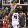 Sacramento Kings guard Tyreke Evans, right, drives to the basket against Atlanta Hawks forward Al Horford during the first half of an NBA basketball game in Sacramento, Calif., Friday, Nov. 16, 2012. (AP Photo/Rich Pedroncelli)