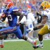 Photo -   Florida running back Mike Gillislee (23) outruns LSU safety Eric Reid (1) for his second touchdown during the second half of an NCAA college football game, Saturday, Oct. 6, 2012, in Gainesville, Fla. (AP Photo/Phil Sandlin)