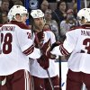 Photo - Phoenix Coyotes' Lauri Korpikoski (28), Derek Morris (53) and Keith Yandle (3) celebrate a goal against the Edmonton Oilers during the first period of an NHL hockey game Friday, Jan. 24, 2014, in Edmonton, Alberta. (AP Photo/The Canadian Press, Jason Franson)