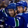 Vancouver Canucks\' Dan Hamhuis, left, and Henrik Sedin, of Sweden, celebrate Hamhuis\' goal against the Los Angeles Kings during the first period of an NHL hockey game in Vancouver, British Columbia, Saturday, March 2, 2013. (AP Photo/The Canadian Press, Darryl Dyck)
