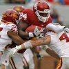 Oklahoma\'s Dejuan Miller (24) tries to get past Iowa State\'s Leonard Johnson (23) and A.J. Klein during a college football game between the University of Oklahoma Sooners (OU) and the Iowa State University Cyclones (ISU) at Gaylord Family-Oklahoma Memorial Stadium in Norman, Okla., Saturday, Nov. 26, 2011. Photo by Bryan Terry, The Oklahoman