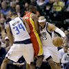 Dallas Mavericks\' Brandan Wright (34) sets the pick as Vince Carter (25) gets around Houston Rockets\' James Harden, center, in the first half of an NBA basketball game, Wednesday, March 6, 2013, in Dallas. (AP Photo/Tony Gutierrez)