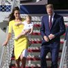 Britain\'s Prince William with his wife Kate, Duchess of Cambridge, and Prince George, arrives in Sydney Wednesday, April 16, 2014. The royal couple are on a three-week tour of Australia and New Zealand, the first official trip overseas with their son, Prince George. (AP Photo/Rob Griffith)