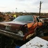 A car lays among the wreckage of a home flattened by a tornado in Smithville, Mississippi on Wednesday, April 27, 2011.(AP Photo/The Northeast Mississippi Daily Journal, C. Todd Sherman)