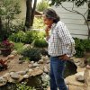 Indian artist and poet Joe Dale Tate Nevaquaya walks through a garden in the backyard of his Norman home. PHOTO BY STEVE SISNEY, THE OKLAHOMAN STEVE SISNEY - THE OKLAHOMAN