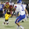 Putnam City North\'s Nathaniel Ocran (24) carries the ball for a long gain during a high school football game between Putnam City North and Moore at Putnam City Stadium in Oklahoma City, Thursday, Sept. 27, 2012. Photo by Nate Billings, The Oklahoman