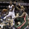 Charlotte Bobcats\' Kemba Walker, left, looks to pass as Milwaukee Bucks\' Monta Ellis, center, and Samuel Dalembert, right, defend during the first half of an NBA basketball game in Charlotte, N.C., Monday, Nov. 19, 2012. (AP Photo/Chuck Burton)