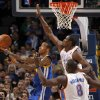 Oklahoma City\'s Serge Ibaka (9) and Nazr Mohammed (8) defend Golden State\'s Monta Ellis (8) during the NBA basketball game between the Oklahoma City Thunder and the Golden State Warriors at the Oklahoma City Arena, Tuesday, March 29, 2011. Photo by Bryan Terry, The Oklahoman