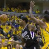 Sacramento Kings\' James Johnson loses control of the ball along the baseline in front of Indiana Pacers\' Paul George in an NBA basketball game in Indianapolis on Saturday, Nov. 3, 2012. (AP Photo/Doug McSchooler)