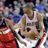 Photo - Portland Trail Blazers forward Nicolas Batum, right, from France,  looks to pass as Washington Wizards forward Trevor Ariza defends during the first half of an NBA basketball game in Portland, Ore., Thursday, March 20, 2014. (AP Photo/Don Ryan)