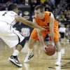 Oklahoma\'s Keiton Page (12) looks to get by Missouri\'s Phil Pressey (1) during the Big 12 tournament men\'s basketball game between the Oklahoma State Cowboys and Missouri Tigers the Sprint Center, Thursday, March 8, 2012. Photo by Sarah Phipps, The Oklahoman