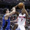 Detroit Pistons guard Brandon Knight (7) tries to get off a shot against Orlando Magic guard J.J. Redick, left, in the second half of an NBA basketball game Tuesday, Jan. 22, 2013, in Detroit. Knight led the Pistons with 18 points in a 105-90 win over the Magic. (AP Photo/Duane Burleson)