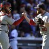 Photo -   St. Louis Cardinals' Tony Cruz and Jason Motte (30) celebrate their 5-4 victory in 10 innings over the Chicago Cubs in a baseball game Saturday, Sept. 22, 2012, in Chicago. (AP Photo/Jim Prisching)