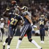 St. Louis Rams cornerback Bradley Fletcher celebrates with Quintin Mikell (27) after intercepting a pass against the Seattle Seahawks during the fourth quarter of an NFL football game, Sunday, Sept. 30, 2012, in St. Louis. The Rams won 19-13. (AP Photo/St. Louis Post-Dispatch, Chris Lee) EDWARDSVILLE INTELLIGENCER OUT; THE ALTON TELEGRAPH OUT