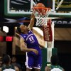 Photo - Northwestern State  guard Brison White (22) scores over Baylor forward Rico Gathers (2) and  guard Gary Franklin during the first half of an NCAA college basketball game, Wednesday, Dec. 18, 2013, in Waco, Texas. (AP Photo/Waco Tribune Herald, Rod Aydelotte)
