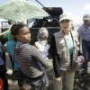 Photo - U.S. Agency for International Development (USAID) Assistant Administrator for Humanitarian Assistance, Nancy Lindborg, arrives in a staging area for typhoon victims trying to evacuate the airport in Tacloban, Philippines, Monday, Nov. 18, 2013. Hundreds of thousands of people were displaced by Typhoon Haiyan, which tore across several islands in the eastern Philippines on Nov. 8. (AP Photo/Wally Santana)