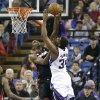 Photo - Miami Heat  forward Chris Bosh, left, blocks the shot of Sacramento Kings forward Jason Thompson during the first quarter of an NBA basketball game in Sacramento, Calif., Saturday, Jan. 12, 2013. (AP Photo/Rich Pedroncelli)