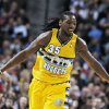 Photo - Denver Nuggets forward Kenneth Faried celebrates after scoring a basket against the Chicago Bulls in the second quarter of an NBA basketball game in Denver on Thursday, Feb. 7, 2013. (AP Photo/David Zalubowski)