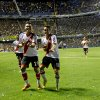 Photo - River Plate's Manuel Lanzini, center right, celebrates with teammate Teofilo Gutierrez, left, after scoring against Boca Juniors during an Argentine league soccer match in Buenos Aires, Argentina, Sunday, March 30, 2014. (AP Photo/Victor R. Caivano)