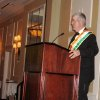 ST. PATRICK\'S GRAND MARSHAL BALL...2009 Grand Marshal Stan Hupfeld talks to the guests. (Photo by Helen Ford Wallace).