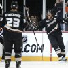 Photo - Anaheim Ducks' Teemu Selanne, right, of Finland, celebrates after scoring against the Phoenix Coyotes during the first period of an NHL hockey game Friday, Oct. 18, 2013, in Anaheim, Calif. (AP Photo/Jae C. Hong)