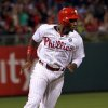Photo - Philadelphia Phillies Domonic Brown runs home to score on a double by Carlos Ruiz in the fourth inning of a baseball game against the St. Louis Cardinals, Saturday, Aug. 23, 2014, in Philadelphia. (AP Photo/Laurence Kesterson)