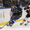 Photo - St. Louis Blues' Roman Polak (46) skates around Ottawa Senators' Clarke MacArthur (16) during the first period of an NHL hockey game, Tuesday, Feb. 4, 2014, in St. Louis. (AP Photo/Bill Boyce)