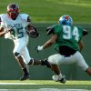 Texas wide receiver Hubert Anyiam (85) from North Garland carries the ball past Oklahoma\'s Marcus Farmer (94) from Stillwater during the first quarter of the 70th Annual Shrine Oil Bowl Classic all-star football game Saturday, June 23, 2007, at Memorial Stadium in Wichita Falls, Texas. (AP Photo/Wichita Falls Times Record News, Jason Palmer) ORG XMIT: TXWIC502