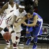 Kentucky\'s Jennifer O\'Neill (0) battles for a loose ball with South Carolina\'s Khadijah Sessions (5) during the first half of their NCAA college basketball game, Thursday, Jan. 24, 2013, in Columbia, S.C. (AP Photo/Mary Ann Chastain)