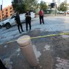 In this photo taken with a fisheye lens, Denver Police Department officers look over the remnants of a water main break in front of Coors Field in Denver that forced the cancellation of a baseball game between the Cincinnati Reds and the Colorado Rockies on Saturday, Aug. 16, 2014. The game will be made up as part of a split doubleheader on Sunday. (AP Photo/David Zalubowski)