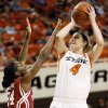 Oklahoma State\'s Liz Donohoe (4) shoots against Oklahoma\'s Sharane Campbell (24) during the Bedlam women\'s college basketball game between Oklahoma State University (OSU) and the University of Oklahoma (OU) at Gallagher-Iba Arena in Stillwater, Okla., Saturday, Feb. 23, 2013. Photo by Nate Billings, The Oklahoman