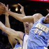 Denver Nuggets\' JaVale McGee (34) blocks the shot of Golden State Warriors\' David Lee during the first half of an NBA basketball game Saturday, Nov. 10, 2012, in Oakland, Calif. (AP Photo/Ben Margot)