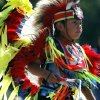 A member of Cheyenne-Arapaho dances in traditional regalia as members of American Indian tribes walk and ride through downtown during the annual 2015 Red Earth Parade in Oklahoma City. The 30th anniversary Red Earth Festival will be June 10-12 in downtown Oklahoma City. The Oklahoman Archives photo