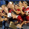 The Oklahoma team cheers during a Women\'s College World Series game at ASA Hall of Fame Stadium in Oklahoma City, Friday, June 1, 2012. Photo by Bryan Terry, The Oklahoman