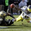 Michigan quarterback Denard Robinson, right, dives to the one-yard line as he\'s tackled by Purdue defensive tackle Kawann Short during the first half of an NCAA college football game in West Lafayette, Ind., Saturday, Oct. 6, 2012. (AP Photo/Michael Conroy)
