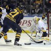 Photo - Buffalo Sabres right winger Drew Stafford (21) pushes the puck past Nashville Predators goaltender Carter Hutton (30) for a goal during the first period of an NHL hockey game in Buffalo, N.Y., Tuesday, March 11, 2014. (AP Photo/Gary Wiepert)