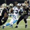 Photo - Carolina Panthers' DeAngelo Williams (34) breaks away for a 65-heard run during the first half of an NFL football game against the New Orleans Saints Sunday, Dec. 30, 2012, in New Orleans. (AP Photo/Dave Martin)
