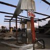 A steel frame is all that remains of the fuel stand at Cheatham\'s Grocery Store in Coy, Miss., following a tornado touchdown Wednesday, April 27, 2011. Several tornadoes hit in the state resulting in number of deaths. (AP Photo/Rogelio V. Solis)
