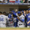 Photo - The Los Angeles Dodgers surround Adrian Gonzalez with the