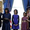 President Barack Obama is officially sworn-in by Chief Justice John Roberts in the Blue Room of the White House during the 57th Presidential Inauguration in Washington, Sunday, Jan. 20, 2013. Next to Obama are first lady Michelle Obama, holding the Robinson Family Bible, and daughters Malia and Sasha. (AP Photo/Larry Downing, Pool) ORG XMIT: WX309
